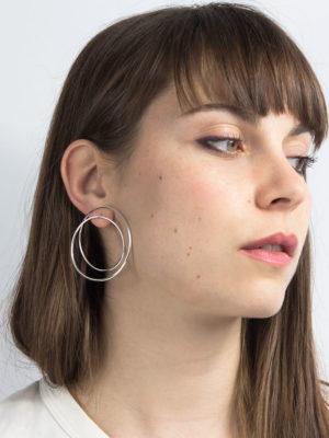 Twist earrings silver on the ear